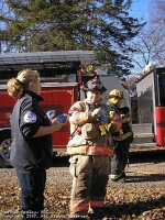 BRS Cadet Nikki Hoffman provides FF B. Ricks with water while operating at a Structure Fire on Rt 28 in the North Branch section of the township 11-25-2007