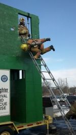 Firefighter Cody Killingsworth doing the window bail out