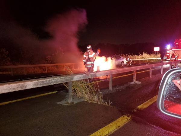 Crews respond to vehicle vs guardrail, sparking a vehicle fire