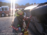 a SVFC firefighter uses the  junkyard dogs to stabilize a vehicle on its side durning a training exercise.