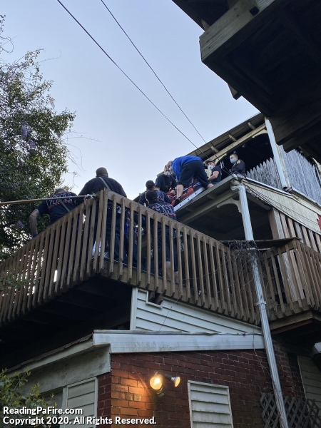 Injured Civilian Rescued From 2nd Story Roof