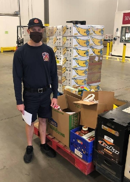 Firefighters Donate To Food Bank