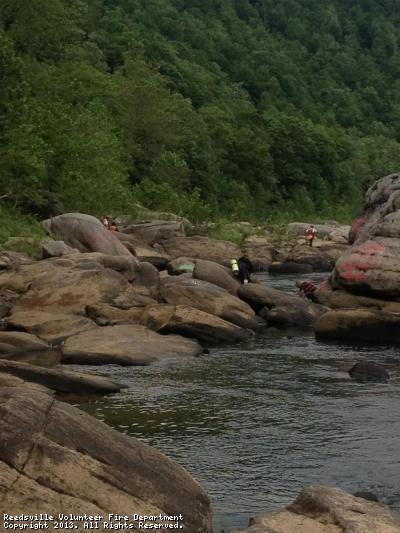 Rescuers  search a rocky area in Cheat River