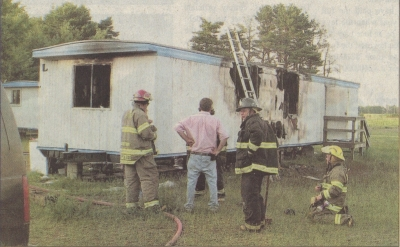 Mobile home fully involved upon arrival.
