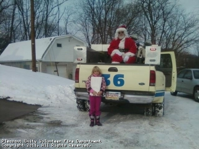 Santa Claus gives a treat to a local child.