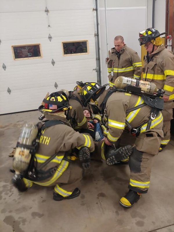 CPR on a Firefighter wearing SCBA