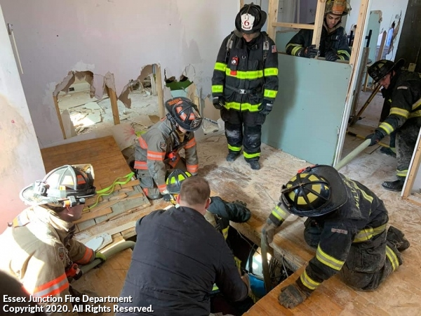 EJFD trained with Williston Fire and Malletts Bay Fire on firefighter rescue from a basement where the stairs may be inaccessible