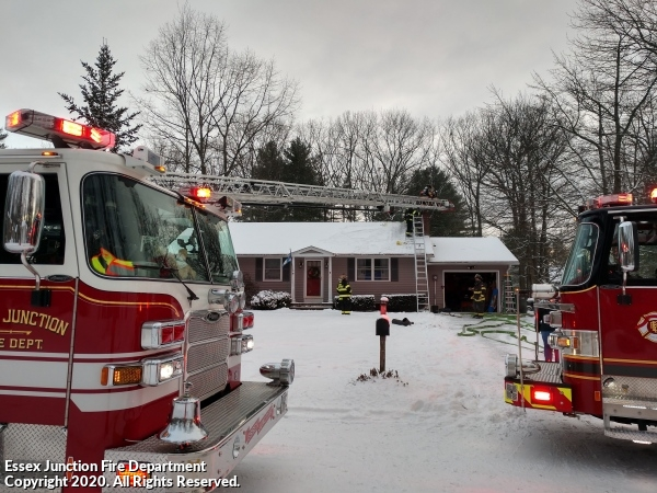 Ladder 3 and Essex Engine 1 operating at a chimney fire in December 2020