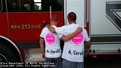 Mr. Tony Carulli and Marchello Carulli, father and son, pose for a photo in support of the 24th Annual Susan G. Komen - Pittsburgh Race For The Cure on Sunday, May 8th, 2016; while representing Team F.D.N.V. / Carulli on the behalf of those F.D.N.V. members who have had a form of cancer.