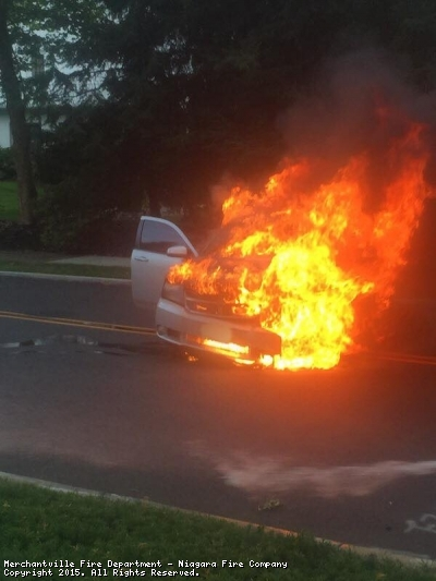 """On August 9th, 2015 at just after 7 PM the Merchantville Fire Department was dispatched to Lexington Ave and Maple Ave for a vehicle fire. Upon arrival Engine 12-92 had a vehicle engine compartment well involved leading off with an 1 3/4"""" hose line to make a quick attack."""