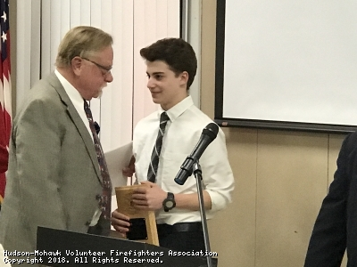 Rich Howland respresenting Senator Kathy Marchione's Office presents a certificate on Senator Marchione's behalf to Gage Nelson of Chatham, NY at the Annual Chatham Fire Department Banquet, April 7, 2018