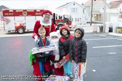 Look at these beautiful faces when these kids received presents from Mr. & Mrs. Claus